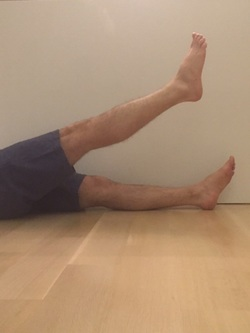 Dr. Gorczynski demonstrates straight leg raise for patellofemoral syndrome