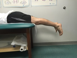 Dr. Gorczynski demonstrates prone hang technique to treat knee flexion contracture