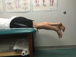 Dr. Gorczynski demonstrates prone hang technique to regain knee extension
