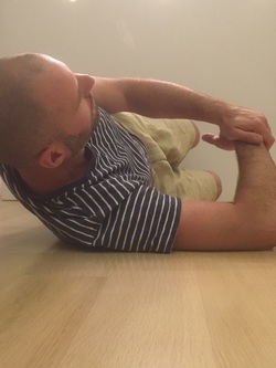 Dr. Gorczynski demonstrates posterior capsule stretch (sleeper stretch)